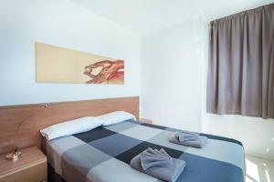 Cama o camas de una habitación en Playa del Ingles 540