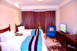 Кровать или кровати в номере Shijiazhuang Xi Mei Business Hotel