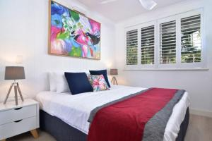 A bed or beds in a room at Paradise Port Douglas #201