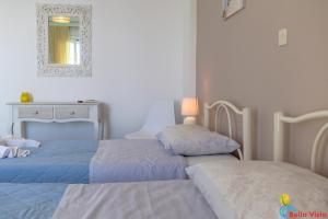 Ένα ή περισσότερα κρεβάτια σε δωμάτιο στο Bella Vista Apartments