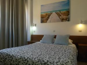 Cama o camas de una habitación en Pensión Milema