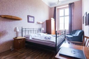 Posteľ alebo postele v izbe v ubytovaní Hotel Kaštieľ Mojmírovce
