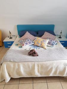 Letto o letti in una camera di Villa Amalfi