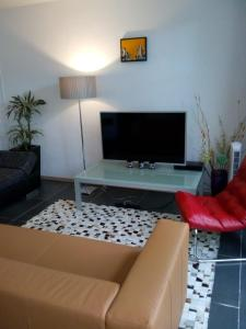 A television and/or entertainment center at Jordaan Canal View Apartment