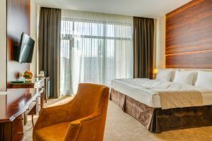Кровать или кровати в номере Viewpoint Hotel