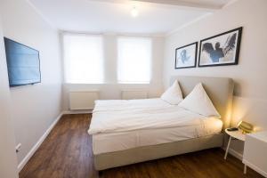 Un ou plusieurs lits dans un hébergement de l'établissement Boutique Charme Apartment