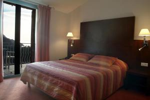 A bed or beds in a room at Capo D'orto