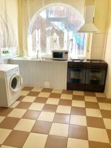 A kitchen or kitchenette at Vodoley+