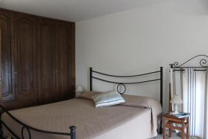 Letto o letti in una camera di La Maiolica Maison