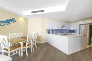 A kitchen or kitchenette at Ocean Views, Unit 24