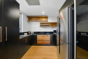 A kitchen or kitchenette at Due North Beach House