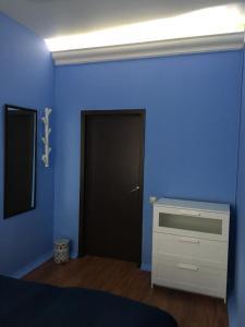 Телевизор и/или развлекательный центр в Houseton Rooms