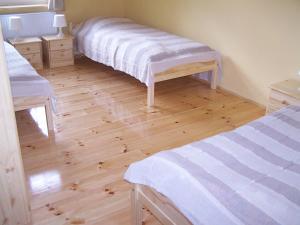 Postel nebo postele na pokoji v ubytování Restaurace U Muzea
