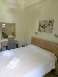 Ένα ή περισσότερα κρεβάτια σε δωμάτιο στο Hotel Pavlos - Studios