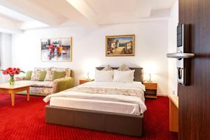 A bed or beds in a room at Bucur Accommodation