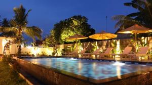 The swimming pool at or near KAYUNA VILLA