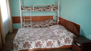A bed or beds in a room at Tatiana Guesthouse