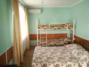 A bunk bed or bunk beds in a room at Tatiana Guesthouse