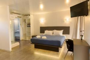 A bed or beds in a room at Undarius Hotel (exclusively gay men)