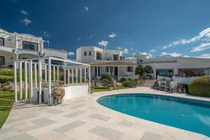 The swimming pool at or near thelocal Hotels Porto Rotondo