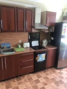 Кухня или мини-кухня в Апартаменты Зорге - Благодатная