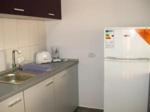 O bucătărie sau chicinetă la Vila Azul