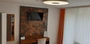 TV/Unterhaltungsangebot in der Unterkunft Hotel am Rossberg