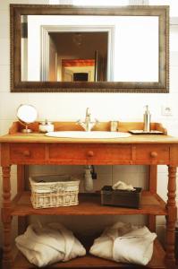 Salle de bains dans l'établissement La Maison du Palmier