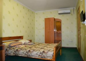 Кровать или кровати в номере Семья