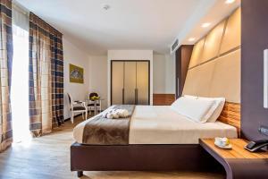 Letto o letti in una camera di San Giorgio Palace Hotel Ragusa Ibla