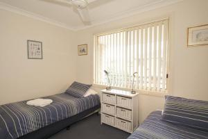 A bed or beds in a room at Blue Haze 4 - Sawtell, NSW