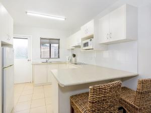 A kitchen or kitchenette at Ocean Sands 3 - Sawtell, NSW