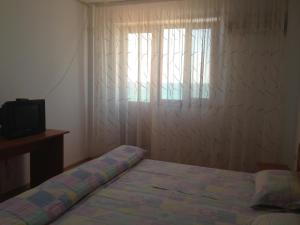 Un pat sau paturi într-o cameră la Vila Eforie Bioterra