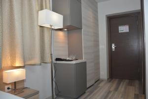 A television and/or entertainment center at Hotel Fiesa