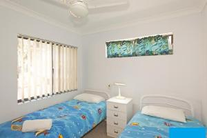 A bed or beds in a room at Ocean Sands 5 - Sawtell, NSW