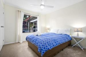 A bed or beds in a room at Zippy's Hideaway - Sawtell, NSW