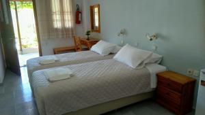 Säng eller sängar i ett rum på Kamelia