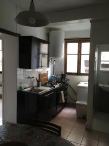 A kitchen or kitchenette at Chez Tibo