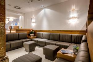 Ein Sitzbereich in der Unterkunft IMLAUER HOTEL PITTER Salzburg