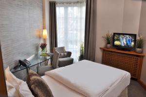 Ein Bett oder Betten in einem Zimmer der Unterkunft Hotel Eggers Hamburg