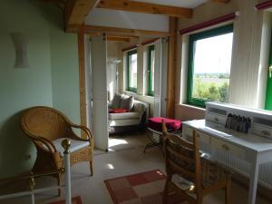 Ein Sitzbereich in der Unterkunft Ferienhaus Luise