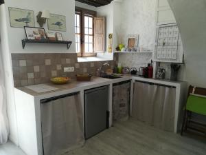 A kitchen or kitchenette at Monaco's Cottage & Spa