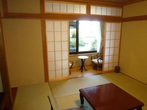 A seating area at Oumeitei Tsuji Ryokan
