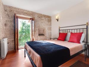 Uma cama ou camas num quarto em Quinta do Bárrio