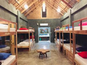 A bunk bed or bunk beds in a room at Hiraya Surf Hostel