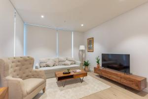 A seating area at Darling Harbour Nordic apt in the heart of Sydney