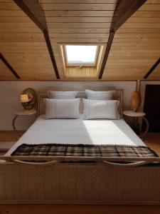 A bed or beds in a room at Verada Tour Guest House