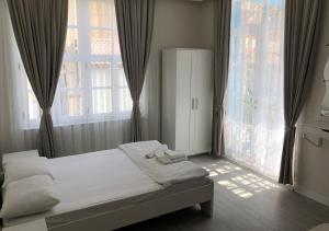 A bed or beds in a room at ATICI HOTEL