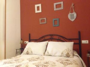 Cama o camas de una habitación en El Salat, alojamientos rurales