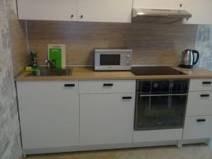 A kitchen or kitchenette at MS Apartments New Boulevard